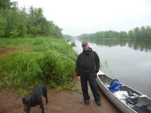 Getting ready to launch the canoes, in the rain and mosquitoes.